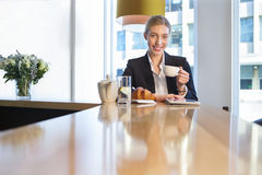 Business woman having breakfast Royalty Free Stock Image