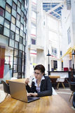 Business woman having coffee break with laptop Stock Images