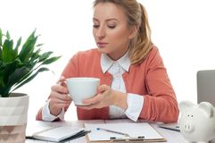 Business woman having a coffee break. Young business woman having a coffee break. Young woman holding cup of coffee Royalty Free Stock Photography