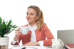 Business woman having a coffee break. Young woman holding cup of coffee Royalty Free Stock Photography