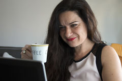 Business woman having coffee at home office desk Royalty Free Stock Images