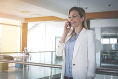 Business woman having discussion on smart phone. Royalty Free Stock Photography