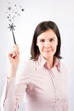 Business woman having a good idea with magic wand. Royalty Free Stock Image