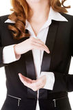 Business woman having hands in front of her belly,empty space. Stock Photography