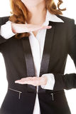 Business woman having hands in front of her belly,empty space. Royalty Free Stock Image