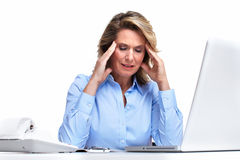 Business woman having a headache. Royalty Free Stock Image