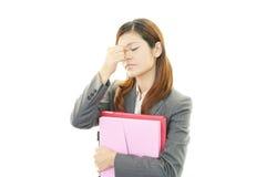 Business woman having a headache Stock Photos