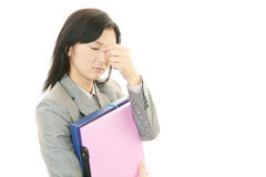 Business woman having a headache Stock Photos