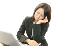 Business woman having a headache Royalty Free Stock Image
