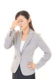 Business woman having a headache Royalty Free Stock Photography