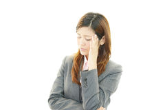 Business woman having a headache Stock Photography