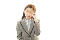 Business woman having a headache Royalty Free Stock Photos