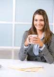 BUsiness woman having her morning coffee Royalty Free Stock Photo