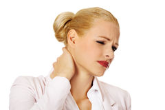 Business woman having huge neck pain Royalty Free Stock Photography