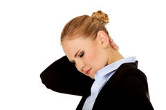 Business woman having huge neck pain Royalty Free Stock Photos