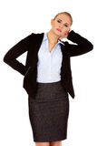Business woman having huge neck pain Royalty Free Stock Image