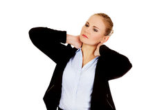 Business woman having huge neck pain Stock Photography