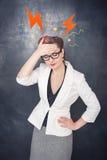 Business woman with headache on blackboard background stock image