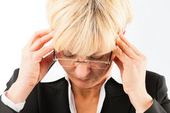 Business woman with headache or burnout Stock Image