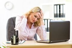 Business woman with headache having stress in the office Royalty Free Stock Photography