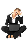 Business woman with headache working on laptop Royalty Free Stock Photos