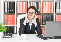 Business woman with headache Stock Photo