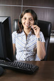 Business woman with headphone Royalty Free Stock Photo