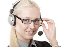 Business woman in headphones. Image of a business woman in headphones on white Royalty Free Stock Photo