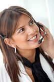 Business woman with a headset Royalty Free Stock Photography