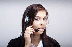 Business woman with headset Royalty Free Stock Images