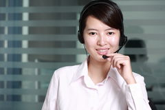 Business woman with headset Royalty Free Stock Image