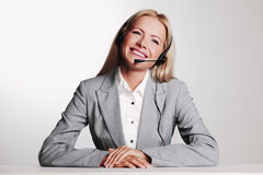 Business woman in a headset Royalty Free Stock Images