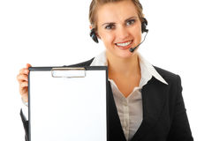 Business woman with headset and blank clipboard Royalty Free Stock Photo
