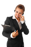 Business woman with headset and clipboard Royalty Free Stock Images
