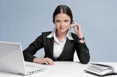 Business woman with headset communication Royalty Free Stock Image