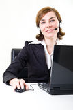 Business woman with headset and PC Royalty Free Stock Images