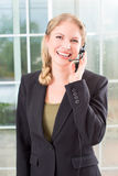 Business woman headset Stock Photography