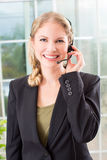 Business woman headset Royalty Free Stock Photos