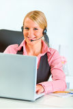 Business woman with headset working on laptop Stock Images