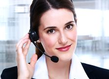 Business woman in headsets. Royalty Free Stock Images