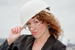 Business woman in the helmet Royalty Free Stock Photography