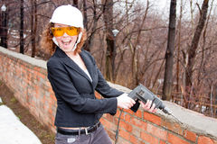 Business woman in a helmet  Royalty Free Stock Photography