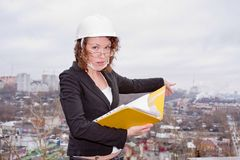 Business woman in a helmet and documents Stock Photos