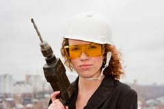 Business woman in a helmet and documents Royalty Free Stock Photo