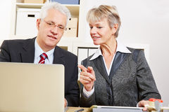 Business woman helping colleague Stock Photo