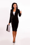 Business woman with her briefcase - walking Stock Images