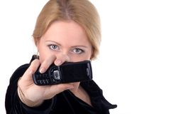Business woman with her cellphone. Attractive business woman showing her cellphone wih focus on eyes Royalty Free Stock Image