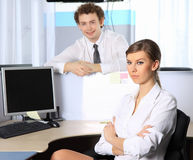 Business woman and her colleague working at office Stock Images