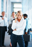 Business woman with her colleagues at the back Royalty Free Stock Photography