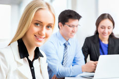 Business woman and her collegues. Business women and her collegues working together in an office Royalty Free Stock Images